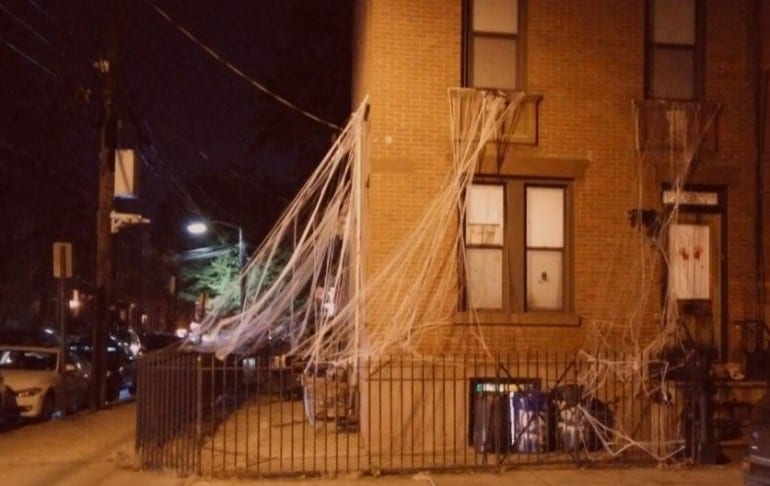 halloween house in hudson county with webs