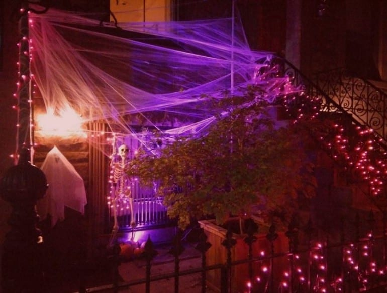 halloween house with webs and ghosts
