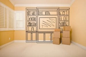 Moving Boxes in Empty Room with Shelf Design Drawing on the Wall.
